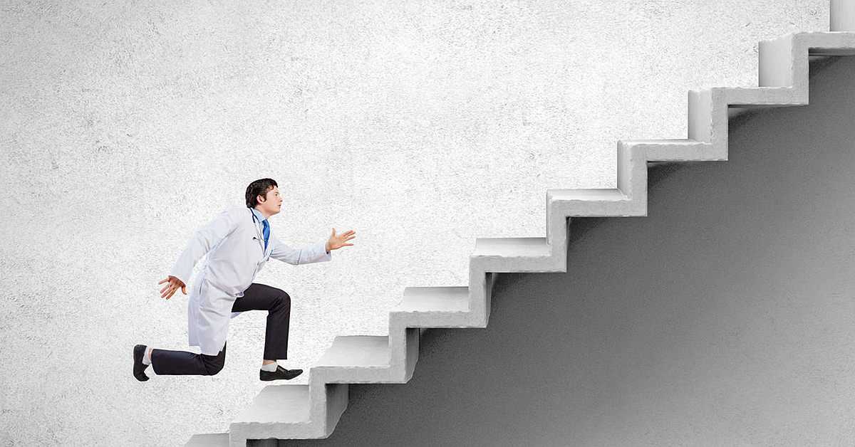 42848793 - young businessman walking up on staircase representing success concept
